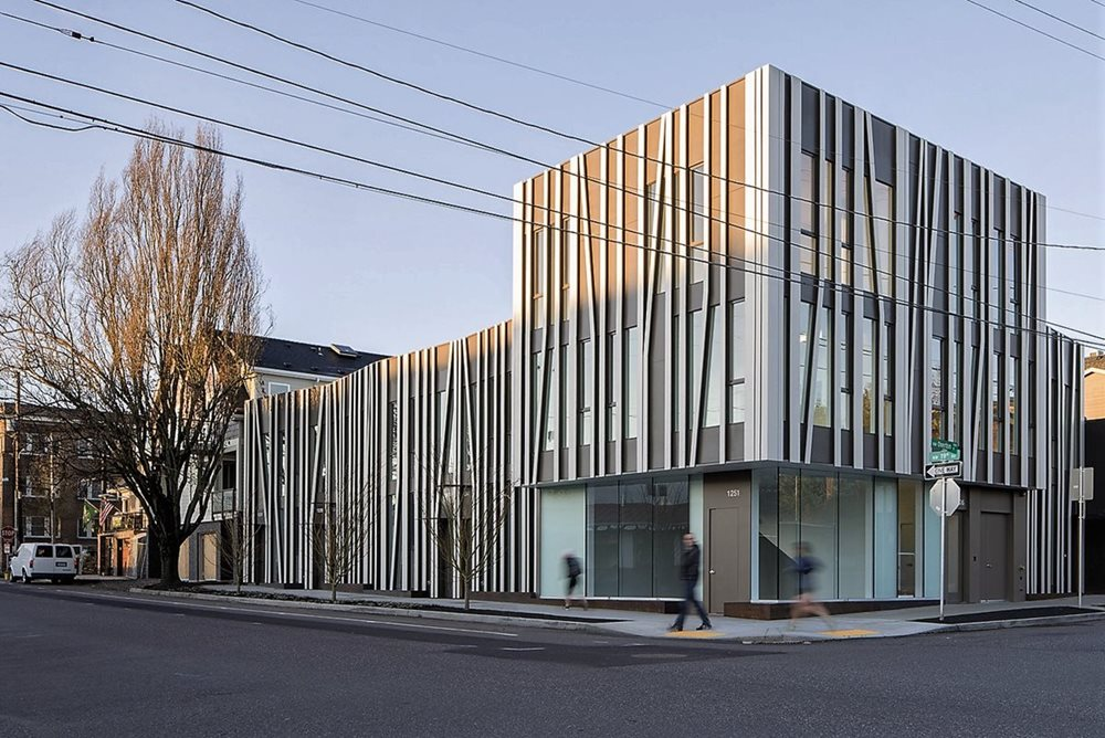 contemporary design with slim vertical shapes over panel siding