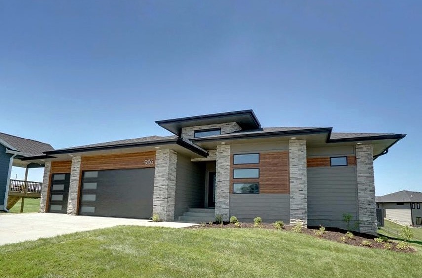 modern design example with lap siding and stone accents