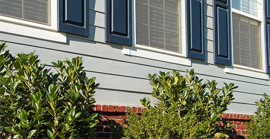 HardiePlank® Lap Siding with Blue Shutters