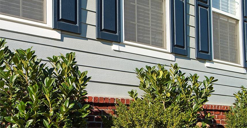 Harplank Lap Siding With Blue Shutters