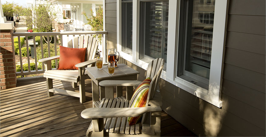 White-HardieTrim-Windows-With-Light-Brown-Chairs-On-Porch