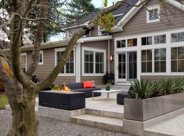 Khaki-Brown-James-Hardie-Fiber-Cement-Siding-With-White-Marble-Deck-Black-Outdoor-Firepit-And-Furniture