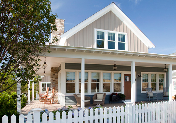 White-Picket-Fencing-Surrounding-Tan-Two-Story-Home