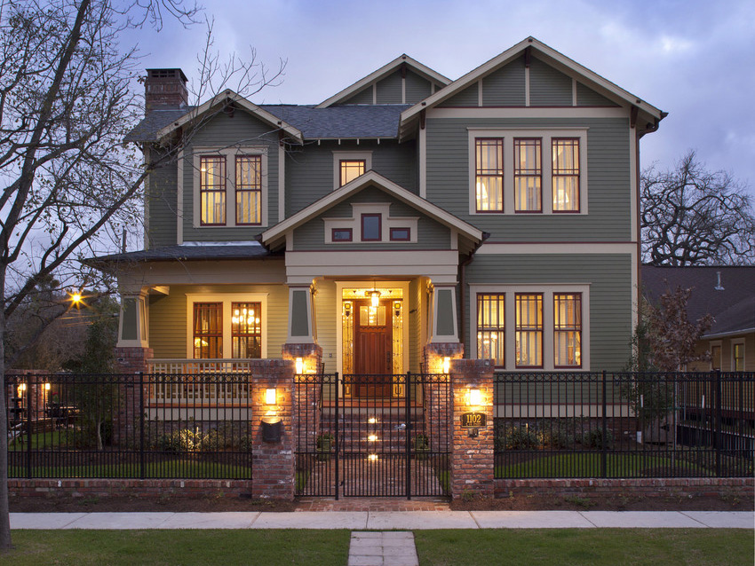 Craftsman-House-In-Night-Gray-HardiePlank-Lap-Siding-With-Black-Fence-And-Stone-Walkway