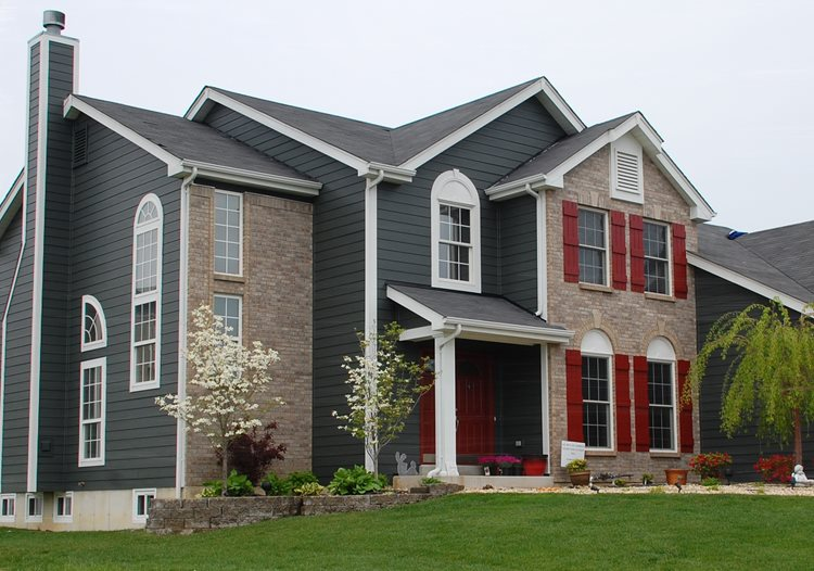 A darker siding and brick combination, with dark gray siding and a dark beige brick color.