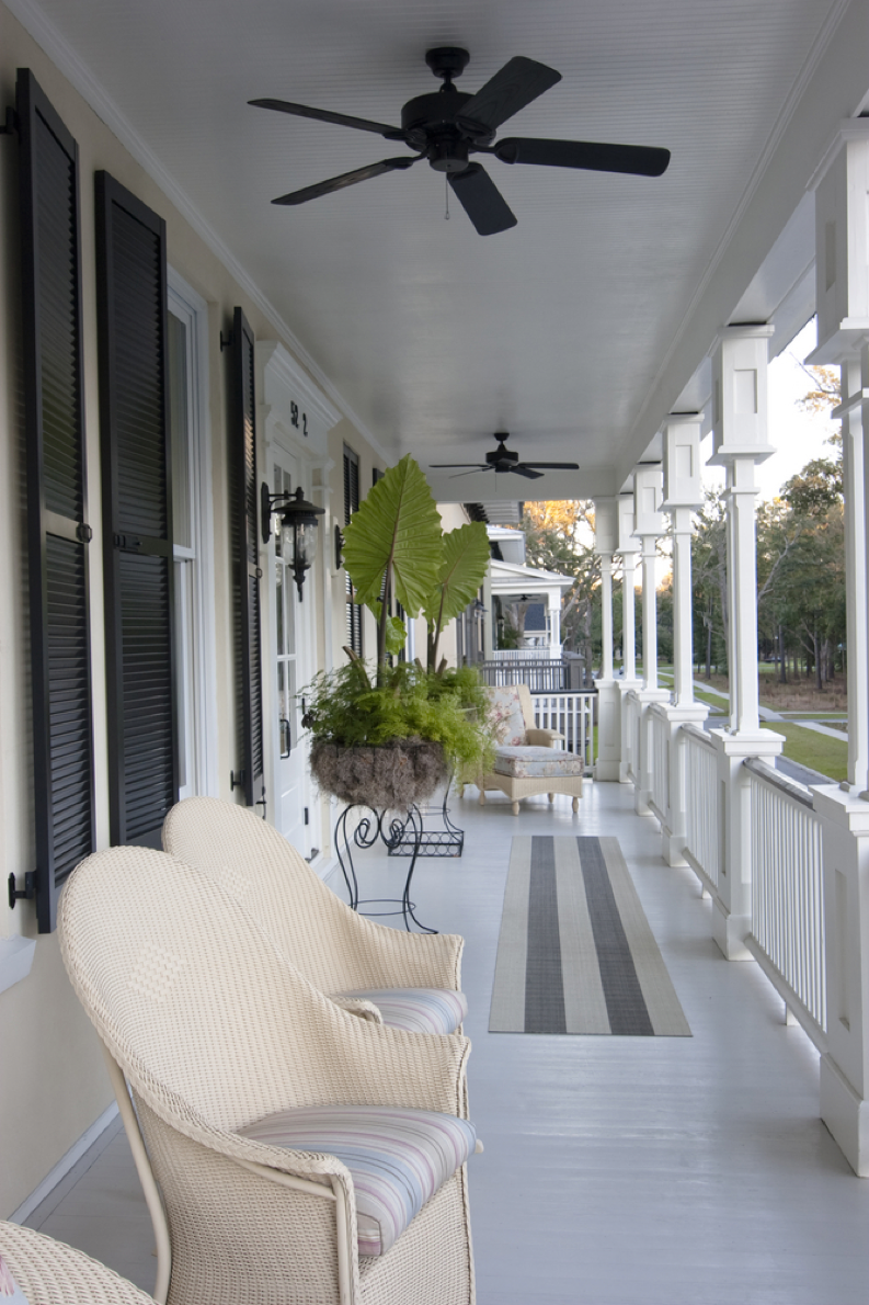 White-Porch-With-Black-Window-Shutters-And-White-Chairs